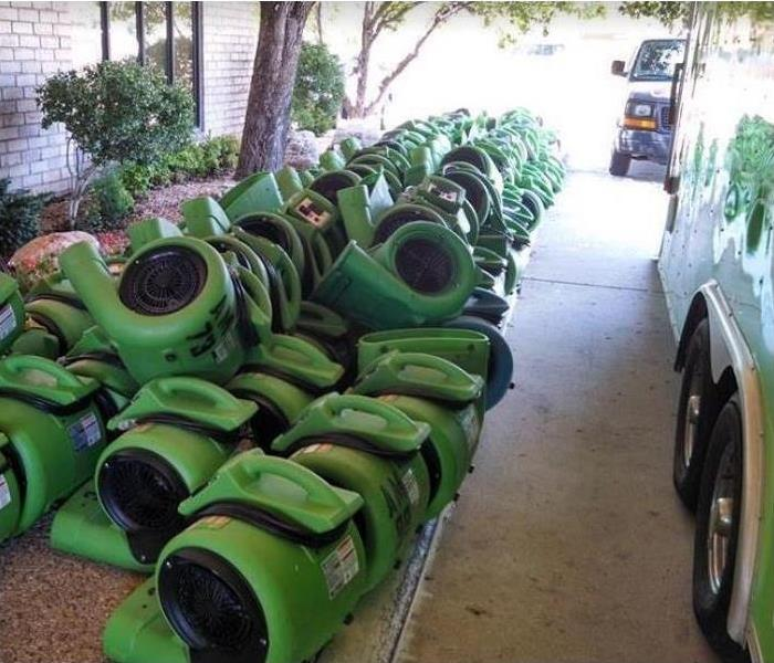 SERVPRO drying equipment stacked outside of home