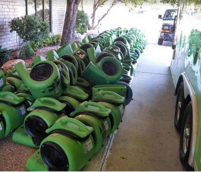 SERVPRO drying equipment stacked by a home