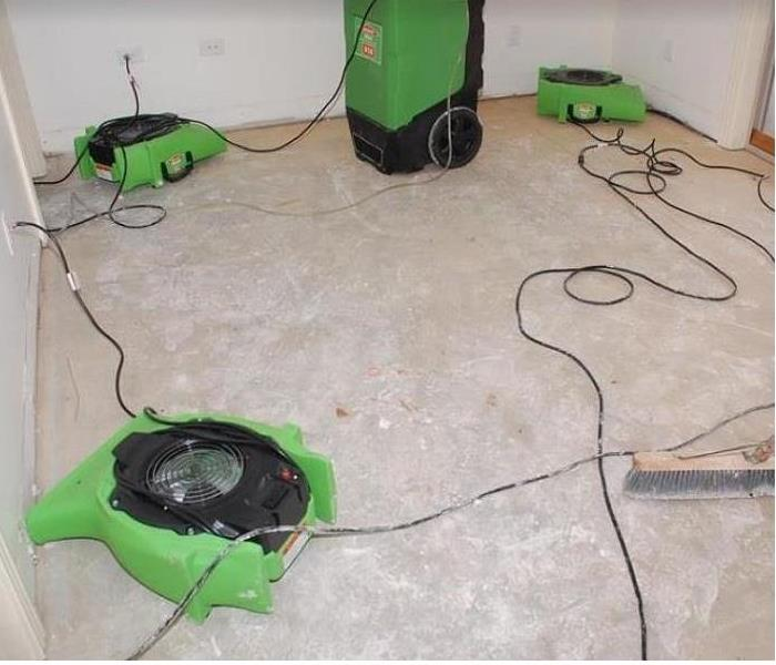 SERVPRO restoration equipment being used in water damaged room