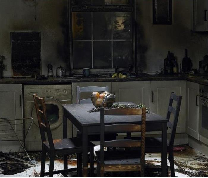 Charred table in fire damaged kitchen