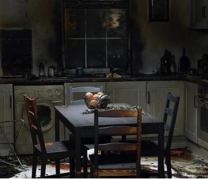 fire damaged kitchen table in kitchen