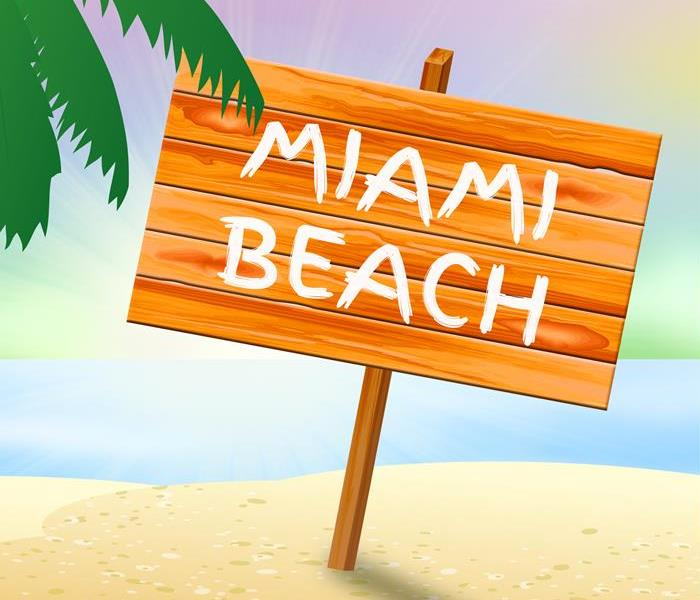 Cartoon photo of a Miami Beach Sign on the beach.